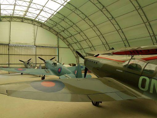 3 Spitfires in a hangar for spitfire tour