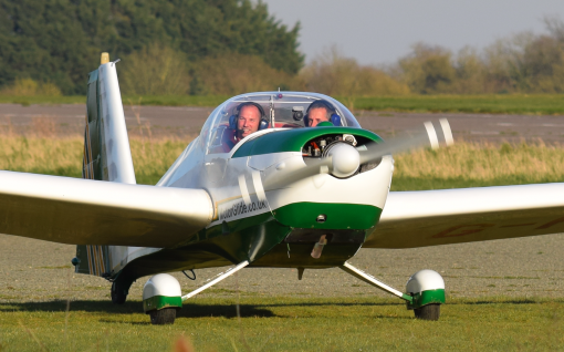 green and white motorglider
